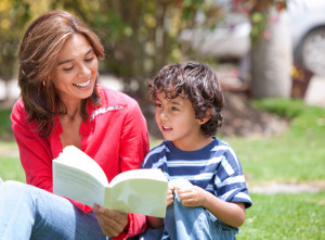 Mother and son at the park reading